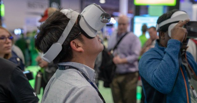 CenturyLink booth attendee using Lenovo Mirage Solo VR headset